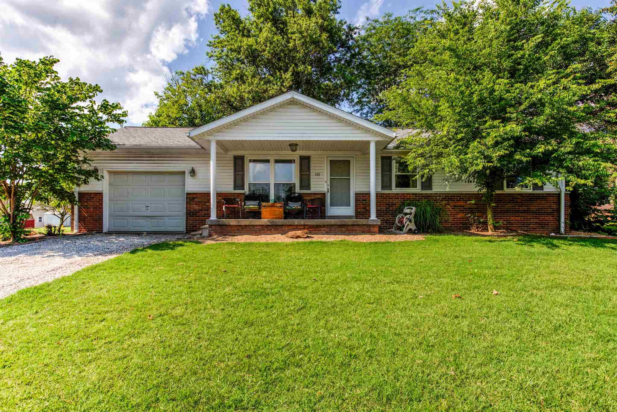 Fantastic family home on quiet lot with plenty of space indoors and out. This 3 bed 2 bath home features a sun room that opens to shaded backyard with a fish pond.  The eat in kitchen opens to the sun room and back patio area for easy entertainment space. There is a single car attached garage.   Behind the home is a two car detached garage for storage and other projects.  The home has a full basement that is partially finished.  Newer paint and floor coverings make the home ready to move in. Great setting with mature trees in a very nice neighborhood.