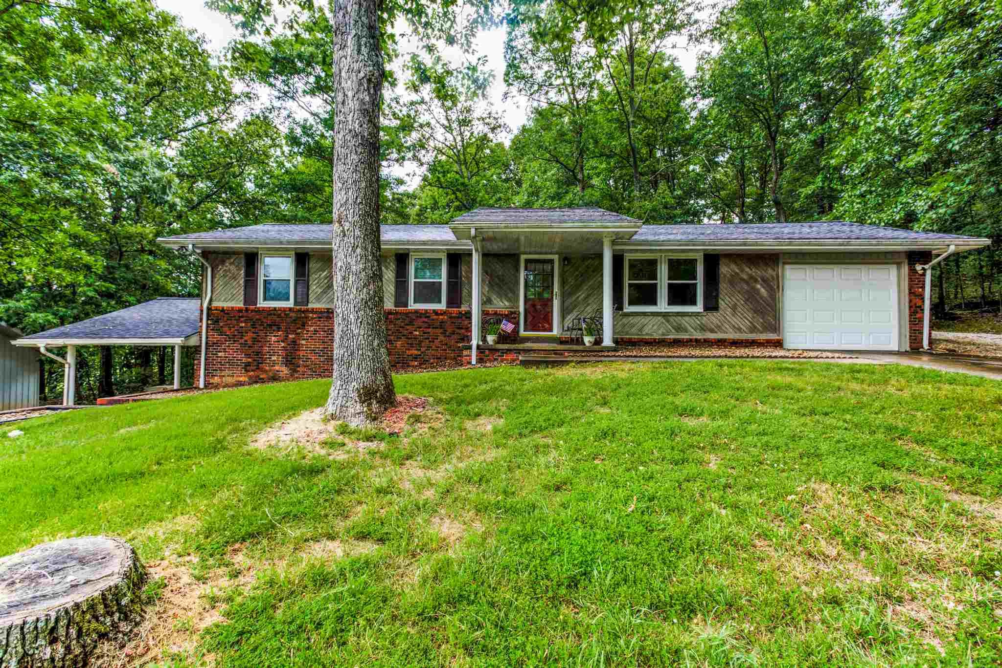 *****Lakeview home in the front of the village*****Incredible ranch home with a LARGE basement for a second family room. This brick ranch features 3 bedroom upstairs, one FULL bath and a half bath in the basement, open floor plan in main area, walkout basement, and nicely updated to move right into. The outside is wonderful. You have a one car garage and carport, nice wooded lot, full length deck of house, two driveways for extra parking, private backyard, lakeview from your front, large lot almost a half an acre. Home has been remodeled. R40 Ceiling insulation and closed cell foam insulation added in 2007. New Roof.  New Windows.  Water View.  Pictures coming July 8th for inside.  Lot 62 on Mistletoe Drive can also be included in the purchase as well.