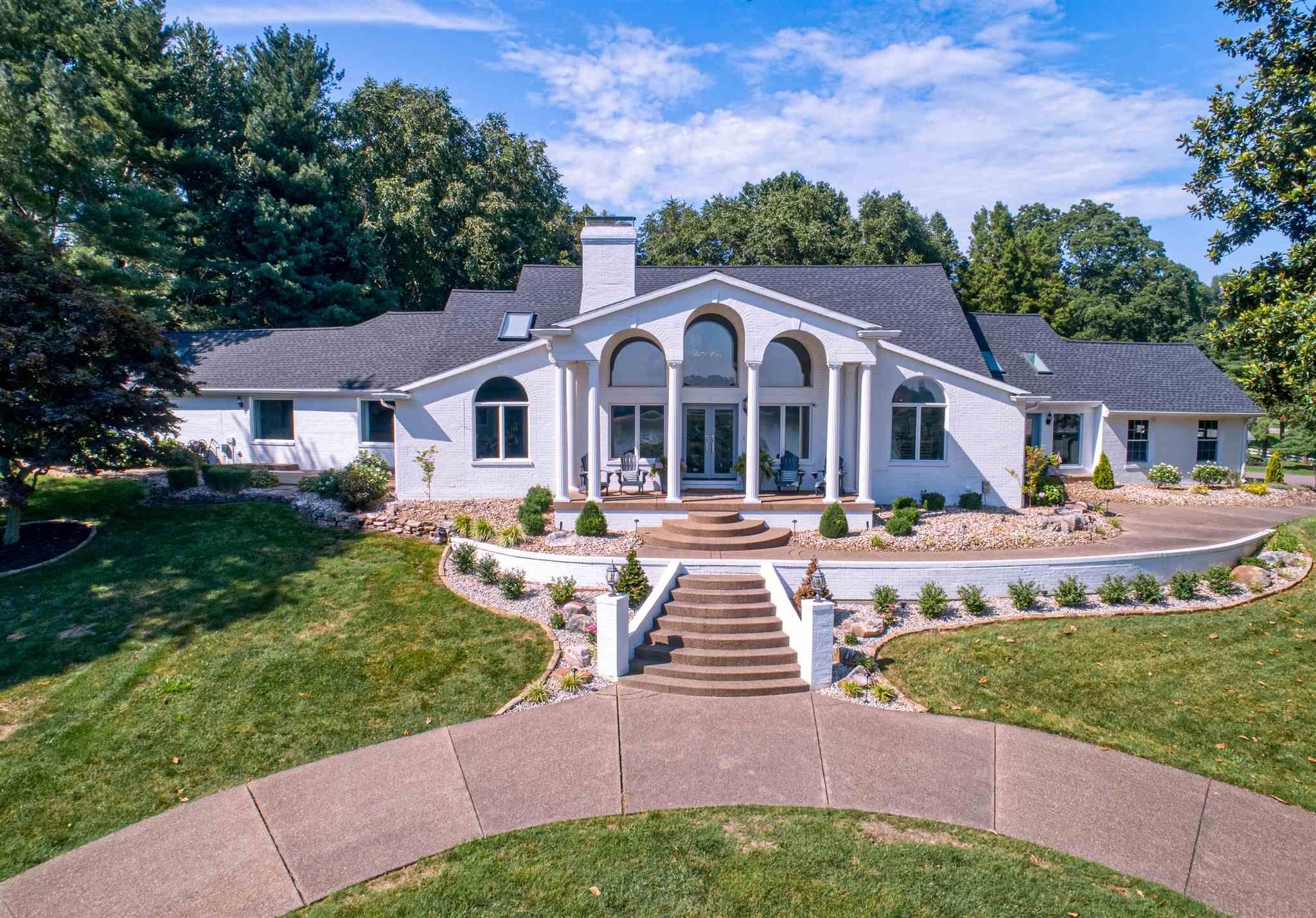 Words alone will not begin to describe this riverfront property. Located along the Ohio River and the French Island Trail, this is truly a grand estate. Situated high on a hill which allows for an unobstructed view of the barges floating down the river while enjoying sunsets and sunrises from the front porch. The long driveway circles around in front of the home leading to the magnificent 2 story entry. The main floor offers a dining room, office, sitting area, huge great room, kitchen, breakfast nook, powder room, multi-purpose room, attached garage and brand new redesigned master suite. Upstairs you will find 3 bedrooms, 2 full baths and a loft area. The finished basement offers a rec room, large laundry with walk-in closet and storm shelter. This almost 3 acre property with a beautiful pool also has a 2 story pool house. The main floor has a large gathering room with a laundry area and full bath. The upper level has an efficiency apartment with kitchen, full bath and sleeping area. The pool house offers a space currently used for a home gym along with a garage to accommodate 2+ Vehicles.  A new play set and utility shed are also found on the grounds. Full list of updates and features can be acquired upon request.