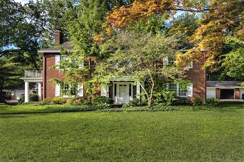 Quality & tasteful touches of the past are reflected in this graceful colonial home. The large entry foyer opens to a formal dining room on the right and a gigantic formal living room graced with a wood burning fireplace and access to a covered porch ideal for your outdoor entertaining. The balance of the main level consists of an offiice/study, bath kitchen and a bfakfast area.  There are hardwood floors under the carpet on both floors according to the owner.  Upstairs consist of 4 bedrooms and a full  bath.  The master suite has two large closets and opens to a balcony. A custom pull down stairs gives you access to lots of storage and possible additional bonus space in the third level of this home. The unfinished basement also provides space for a workshop, hobby area and storage. There is a 2 car garage and a private and scenic backyard space that has access to the PARKLANDS walking path.