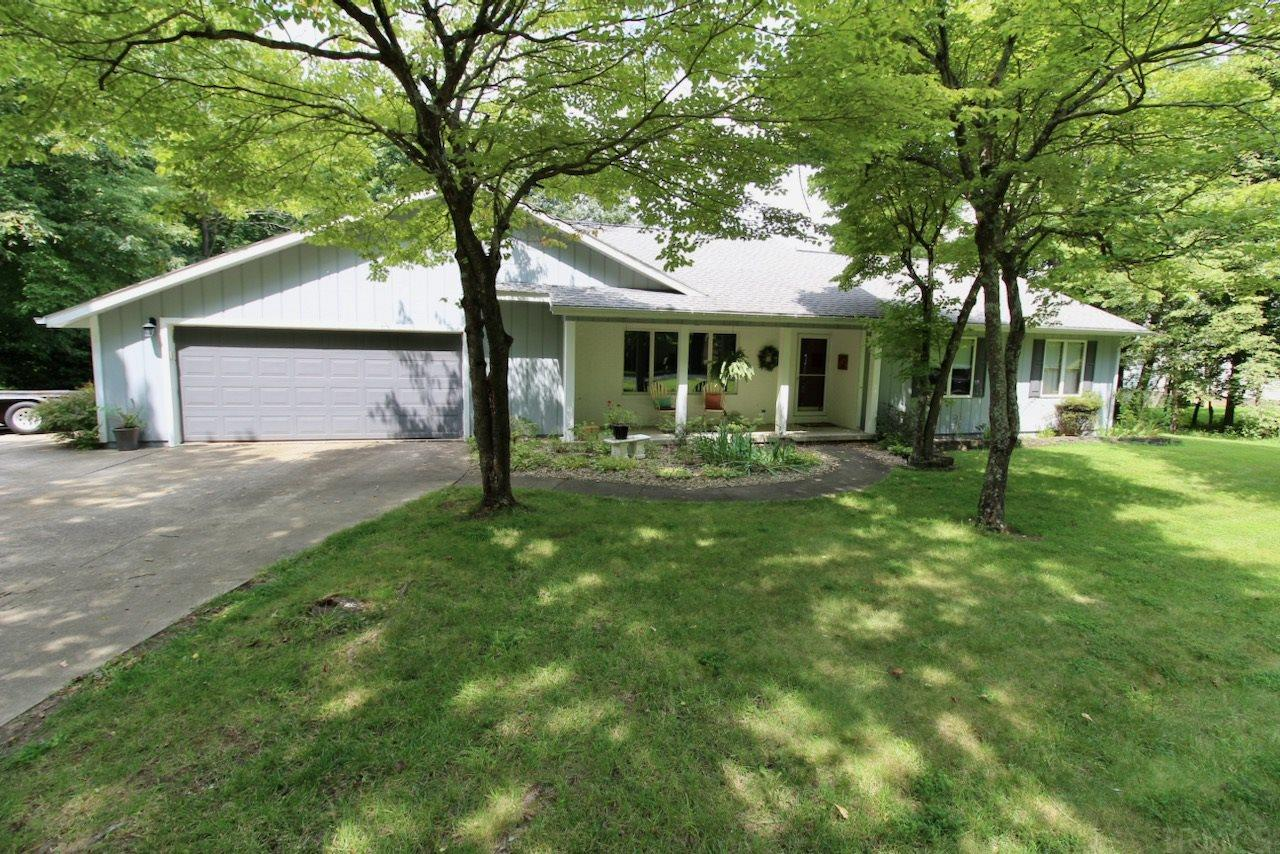 Welcome to 1000 W Sled Circle in Christmas Lake Village! This home sits on a large .66 acre lot with large circular driveway and lots of private space outback. This home offers lots of space and a finished basement! Homeowners installed new hardwood floors in living area, kitchen, hallway & several bathrooms in 2017. Also updated in 2017: New Paint in many rooms, Added 1/2 Bathroom to basement, Painted the kitchen cabinets & painted the garage door. Home offers a front living room space, as well as a family room that's open to the kitchen. Kitchen offers an eat-at bar, plenty of countertop space and a tiled backsplash. The master suite is spacious and offers his & her separate walk-in closets and a full bathroom. The 2nd full bathroom features the updated hardwood floors & updated vanity top. The basement is perfect for extra space for a rec room, playroom, or entertaining space. It also has a newly added 1/2 bathroom, which also has a drain in the floor in case you want to add a tub or shower. There is also plenty of storage in the unfinished area of the basement and it has a walkout exit. Outback there is a covered patio off the family room & kitchen and a wide deck. There is also an outbuilding for additional storage. Sellers are including a $2,000 FLOORING ALLOWANCE at closing to help update carpets in bedrooms and/or basement. Sellers are including a 1 Year Supreme Coverage Home Warranty ($599.)