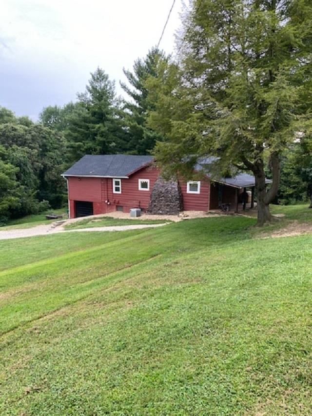 Relax and enjoy this Cozy Country Cabin sitting on 2.2 acres with a 20% ownership in pond. Bird watching and wildlife to enjoy.   This 2 Bedrooms and one bath. There have been many improvements including a new Roof,replacement windows,  septic tank lines and tank pumped 2020, windows, retaining wall, chimney tuck pointed and sealed and new header and posts on the front porch.  The Great room has a Stone wood burning fireplace to warm you on those cold winter days. Breakfast bar has a custom oak counter top. to  the Kitchen is perfect for visits with family and friends. Appliances include a Refrigerator and Range. Large sun room.  The 1 car Garage. Beautiful Lot has a place for a Pole Barn(up to 30X40)