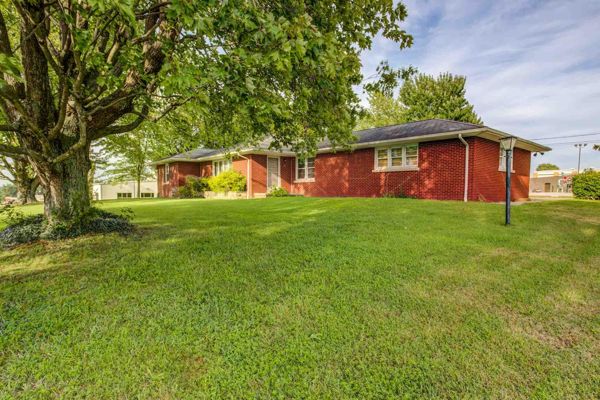 Motivated seller, bring offer! TOWN AND COUNTRY meet with original 60's charm in this brick ranch in the heart of Ferdinand. Enjoy all of the amenities of what Ferdinand has to offer while enjoying tranquility on your own 2.65 acre lot. Inside offers a huge living room with gas fireplace. There is a dining/flex area currently used as an office alongside the eat-in kitchen with all appliances (and vintage rotisserie oven!) included. This home offers vintage pieces one will not be able to find anywhere else, including the oven, original playing card wallpaper, wood burning fireplace in the basement, radiant ceiling heat, and light panels in the basement. Completing the upstairs is three generous sized bedrooms, bathroom, two car garage, and cedar closet along with other storage areas. Traveling downstairs, you will immediately be greeted by the ultimate party/gathering space. Custom barnwood flanks the walls. Dry bar is included, pool table is negotiable. Laundry area is in the basement with washer and dryer negotiable. There is enough space in the area to add another bathroom if desired. Outside, there is a great covered patio perfect for outside dining. Numerous restaurants, walking trails, schools, YMCA, library, and gas are within seconds of this property. Truly a one-of-a-kind property!