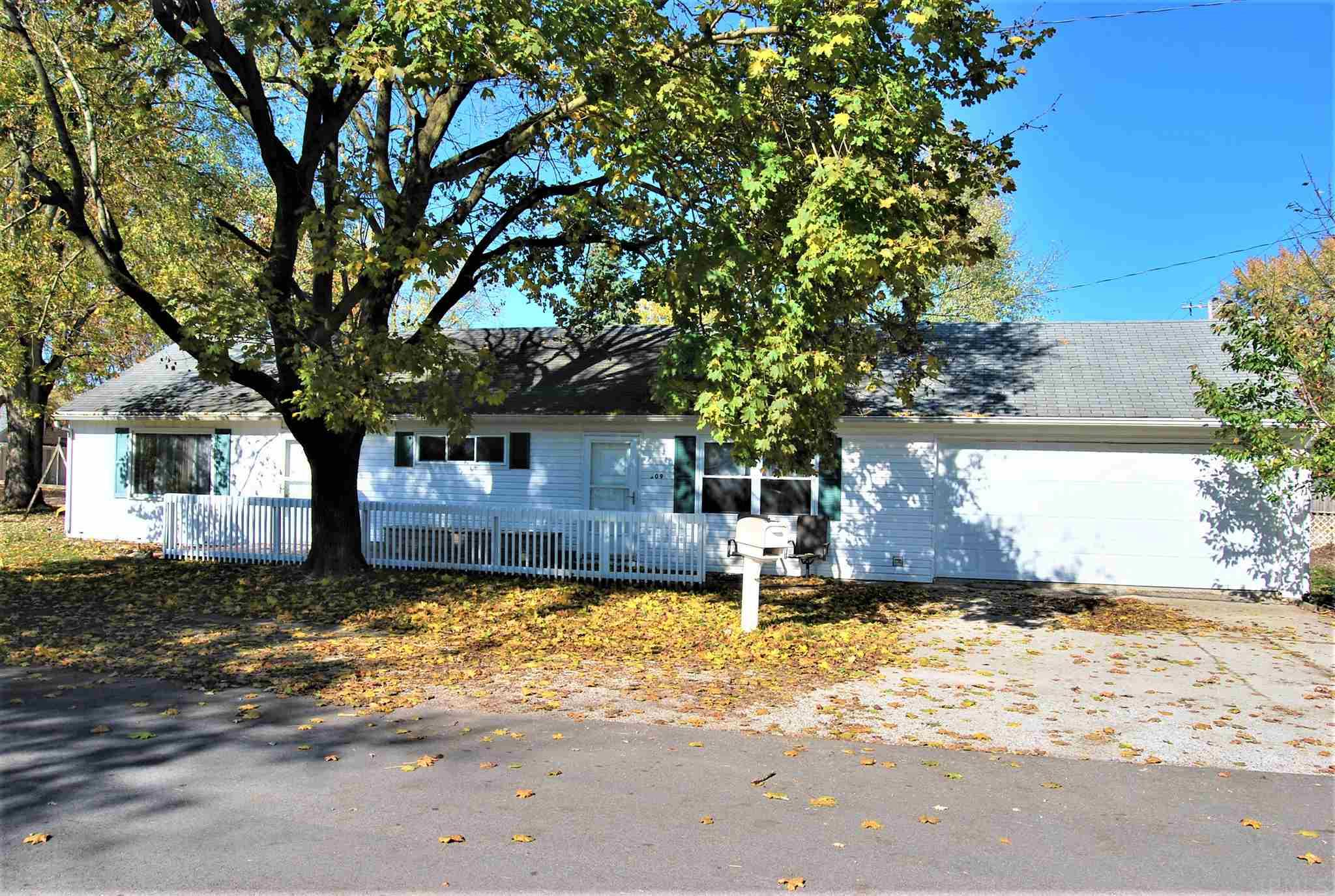 You could move in and celebrate Christmas here! Efficient 4 bedroom 1 bath ranch style home with a large two car garage. New central Air in 2017.  Located just a half block from South Whitley schools. This the perfect home for first time buyers and or families needing another bedroom!