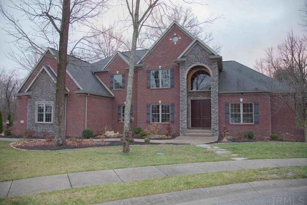 Prepare to be impressed. Executive home in prestigious Woodfield subdivision. So much flexibility in this home. Multiple flex spaces - office - craft - gathering - study rooms. All new paint, carpet, and hardwood flooring. Soaring family room greets you upon entry, with full height fireplace and lots of windows for plenty of natural light. Large kitchen with plenty of cabinets offering lots of storage and large work island adds loads of workspace. Large master bedroom with large private bath. First floor laundry has plenty of space and also has a refrigerator for additional cold storage right off the kitchen. Lower level has finished entertainment area including a full kitchen which walks out to the beautiful in-ground pool and large patio.  The deck and lower level are great for entertaining.  The basement also has ample flex space for crafting/hobbies.  Abundant storage. 4 car garage. You just have to see this home to appreciate the space and flexibility it offers. Home warranty included.