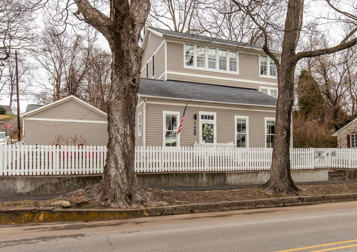 Fabulous home in Historic Newburgh! With River views, 1 block from the Rivertown trail.  The home has been tastefully rebuilt in keeping with Newburgh's Historic charm.  Relax and enjoy the views from the 2 new patio areas, one with a firepit.  Stroll along the River front while you enjoy the shops and restaurants.  This charming home has an abundance of windows to enjoy the views. The 10 ft ceilings give a spacious feeling to the formal living and dining room. The grand updated kitchen with farmhouse sink, gas range, stainless steel appliances all included, breakfast bar, with custom light fixture, pantry, and sitting room with fireplace make this a great gathering area. The the main floor laundry room has the washer and dryer included. The charming half bath is tucked away off the dining room.  The main floor owner's suite is a retreat and has a walk in closet and full bath with double vanity, garden tub and separate shower.  Upstairs has 3 Bedrooms, the 2nd laundry(with washer and dryer included), a bath, and balcony.  The 3rd floor has a family gathering room with spectacular River views, Bedroom and bath. Custom Layfette Roller shades throughout. New kitchen door, and French side door with built in blinds between window panes. Three car garage plus 2 new additional off street parking areas. Seller is including 3rd floor funiture and an AHS Warranty for buyers.