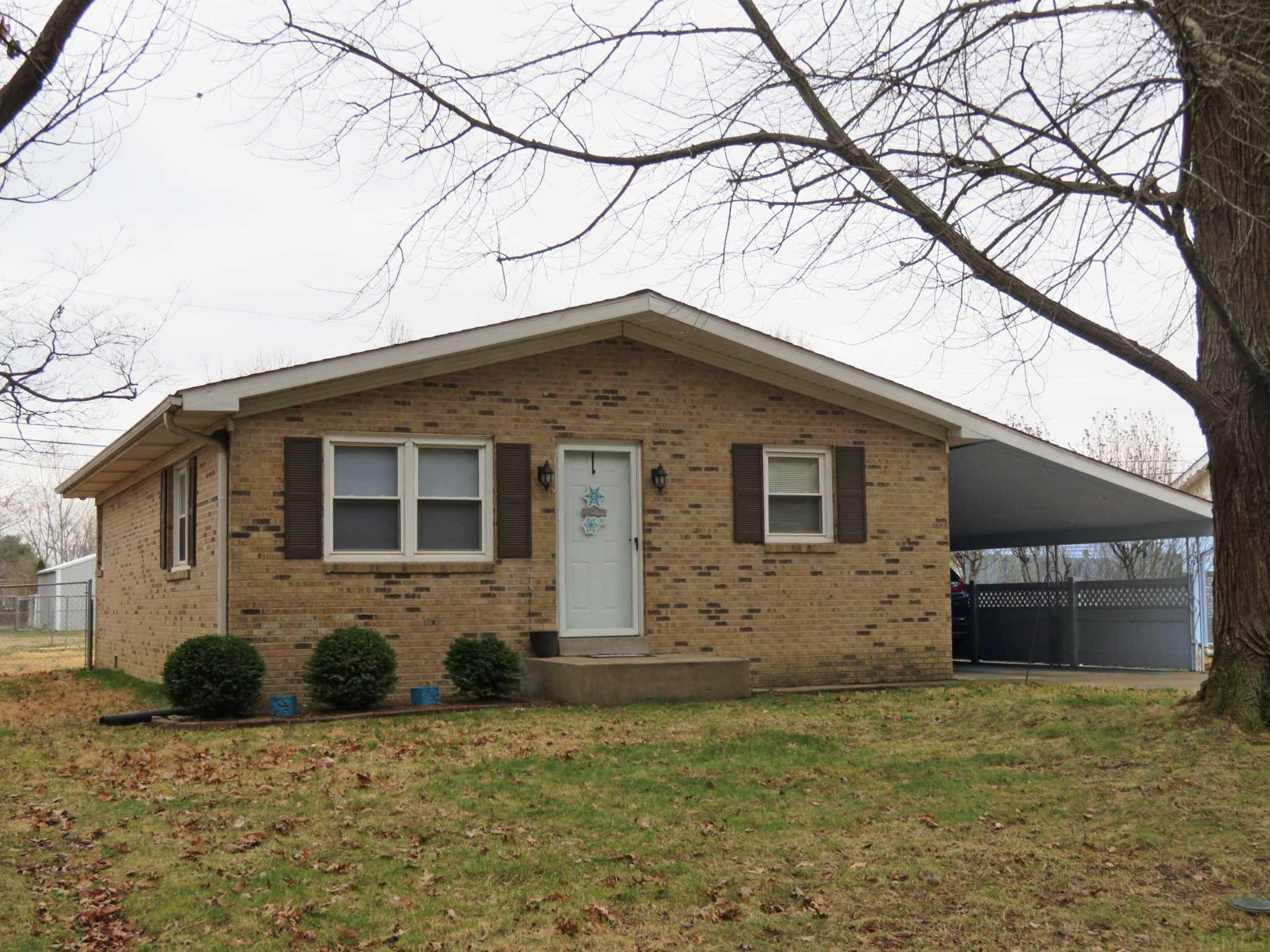 Full Brick Ranch in Newburgh on a 71 x 139 fenced lot!  Perfect starter Home Features an Updated (2020) Spacious Kitchen. Includes All Appliances and there is a Maytag Washer and Dryer.  Two Bedrooms include a 16 x 11 Master with ceiling fan, his and her closets and there is a two compartment Updated, Full Bath with double vanity and tub/shower combo. Some Replacement windows, Lots of Natural Light, New Ceiling Fans, Newer Electric Heat Pump (3 yrs ago) ,  Roof (4 yrs old) Crawl Space, fenced rear yard, 20 x 12 Concrete Patio, 8 x 10 Yard Barn (2006)  and a 14 x 41 Two Car Carport w/storage. Convenient to to I-164 and Evansville