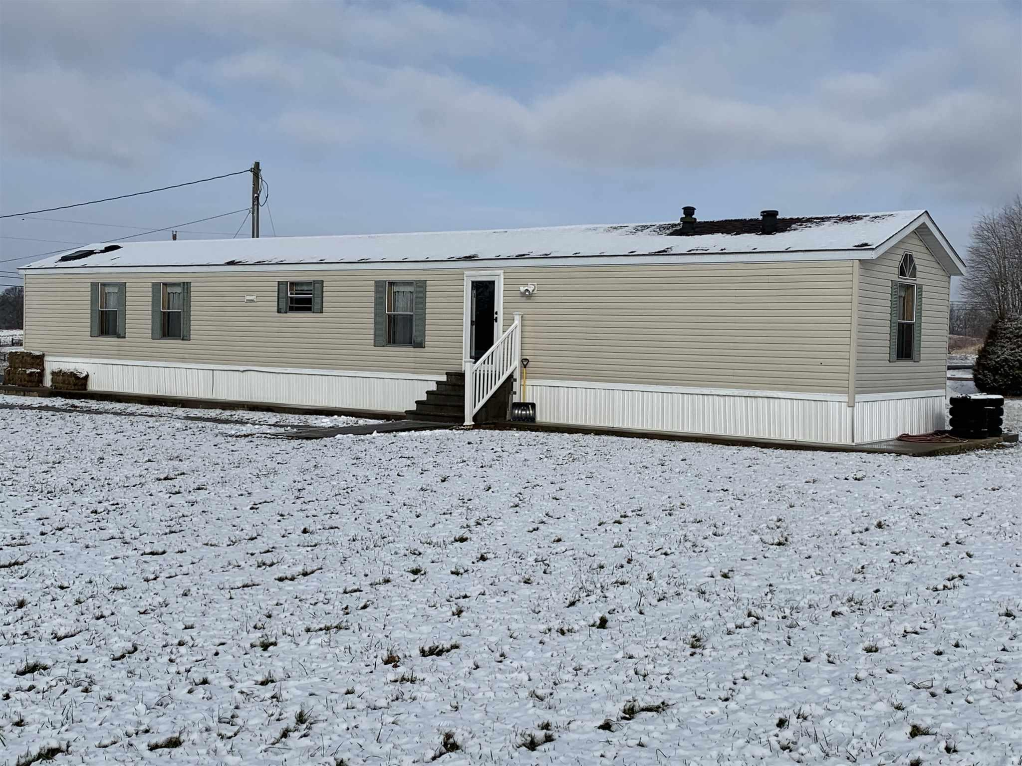 Super clean and ready for new occupancy. This 3 bedroom, 2 bath mobile home sets on 2 country acres overlooking hundreds of more pure country acres. New roof, new entry doors, and other nice updates to this home.