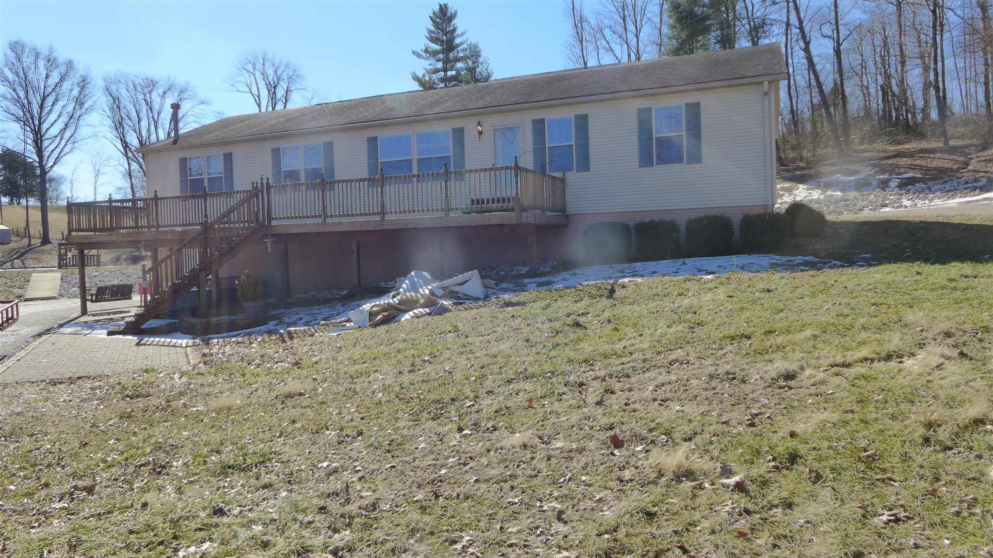 Are you looking for country living near Jasper?  Check out this property in Marion Twp. near Jasper.  These 4.8 acres offer a manufactured residence with 2,432 sq. ft. on the main level plus a poured concrete basement of 2,432 sq. ft with approx. 370 finished sq. ft., a 2-car garage in the lower level, a large deck overlooking the lake, a detached 24' by 32' garage and a pole structure 24' by 44' for a camper and storage, a nice pond with a dock with cover for fishing and recreation.  Also has a 6' by 6' child's playhouse.  Extra large rooms with a family room with fireplace, large kitchen with island bar, 3 bedrooms on the main level and a possible 4 bedroom on the lower level.  This residence has gas heat, central air, new floor coverings and more.  Very well maintained in a nice setting.
