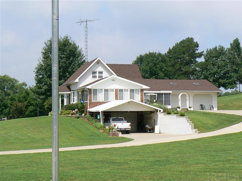 Home on 3.7 acres. This property location is within walking distance to the Schools, town park, library, restaurants, hardware store, gas station, bank, church and post office....wow everything a person would need ....right there.   Park the car and never leave town. The town of Dubois is one of the closest towns to Patoka lake dam, Hoosier Hills Marina and boat ramp.   The home features 3 car attached garage, nice long concrete driveway and single car carport,  walkout basement and screen room.