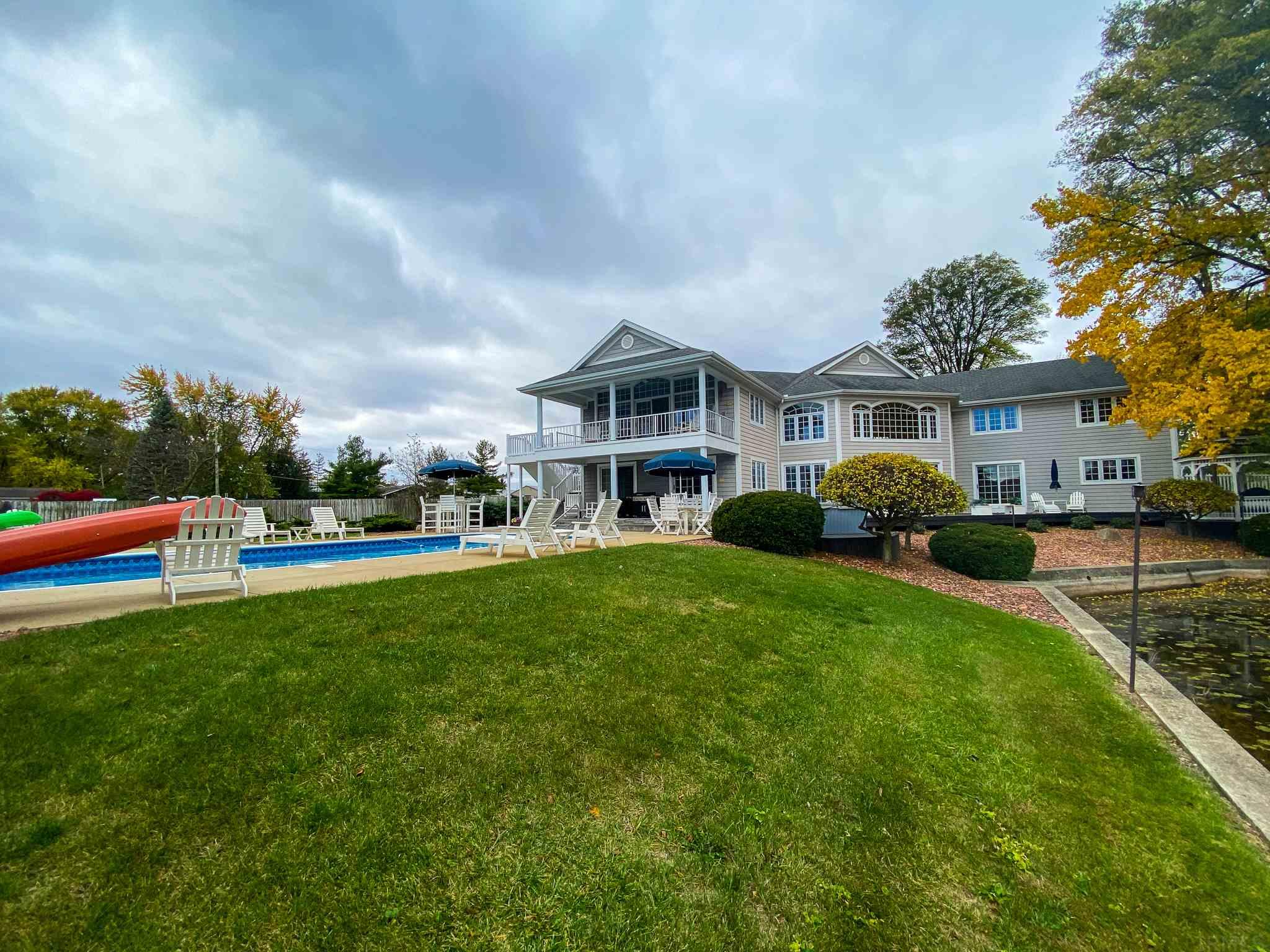"Don't let this catch get away! 150+ Dewart Lakefront + it's own private bay are only the start to this unique 4 BR 3-1/2 BA majestic home. 4,848+/- finished sq ft, lakeside in-ground pool, on nearly 1 acre. Begin your day with coffee & a warm muffin on your private balcony off the master suite, while taking in the magnificent lake & pool views, which can also be enjoyed from the remaining 3 bedrooms, great room, kitchen, dining area & bar room. The massive great room with a ventless gas stone fireplace & built-in cabinets, surrounded by a walk-around loft above will captivate upon entering. Stock the large walk-in pantry with culinary delights to prepare delicious meals in your spacious kitchen boasting a great work island & ample space to prepare large meals. The custom wet bar includes a wine cooler &  ""cafe"" area that opens to the pool. The 1st floor bedroom also opens to the pool area, boasting it's own vanity sink & W/I closet, with a convenient full bath right next door. The large laundry room is conveniently located on the 1st floor. The upper level has extensive storage for your extras. The master suite features a tray ceiling, ceiling fan and opens to the private balcony overlooking the lake & pool. The bath includes a walk-in shower, jetted tub & large walk-in closet. Two more bedrooms & the den/guest room, a sitting area in the loft & another full bath with twin sinks complete the upper story. 2 Geothermal units will keep you comfortable no matter where you are, & the irrigation system will provide less work in the summer. The easily accessible 4' crawl has poured concrete walls & floor, adding even more storage space. Prepare wonderful grilled delights on your hearth-stone paved covered patio in all seasons. There is also 110 and 220 amp service at the lake, a lovely Gazebo, 10' x 16' shed w/2 doors & 2 lofts...and so much more!"