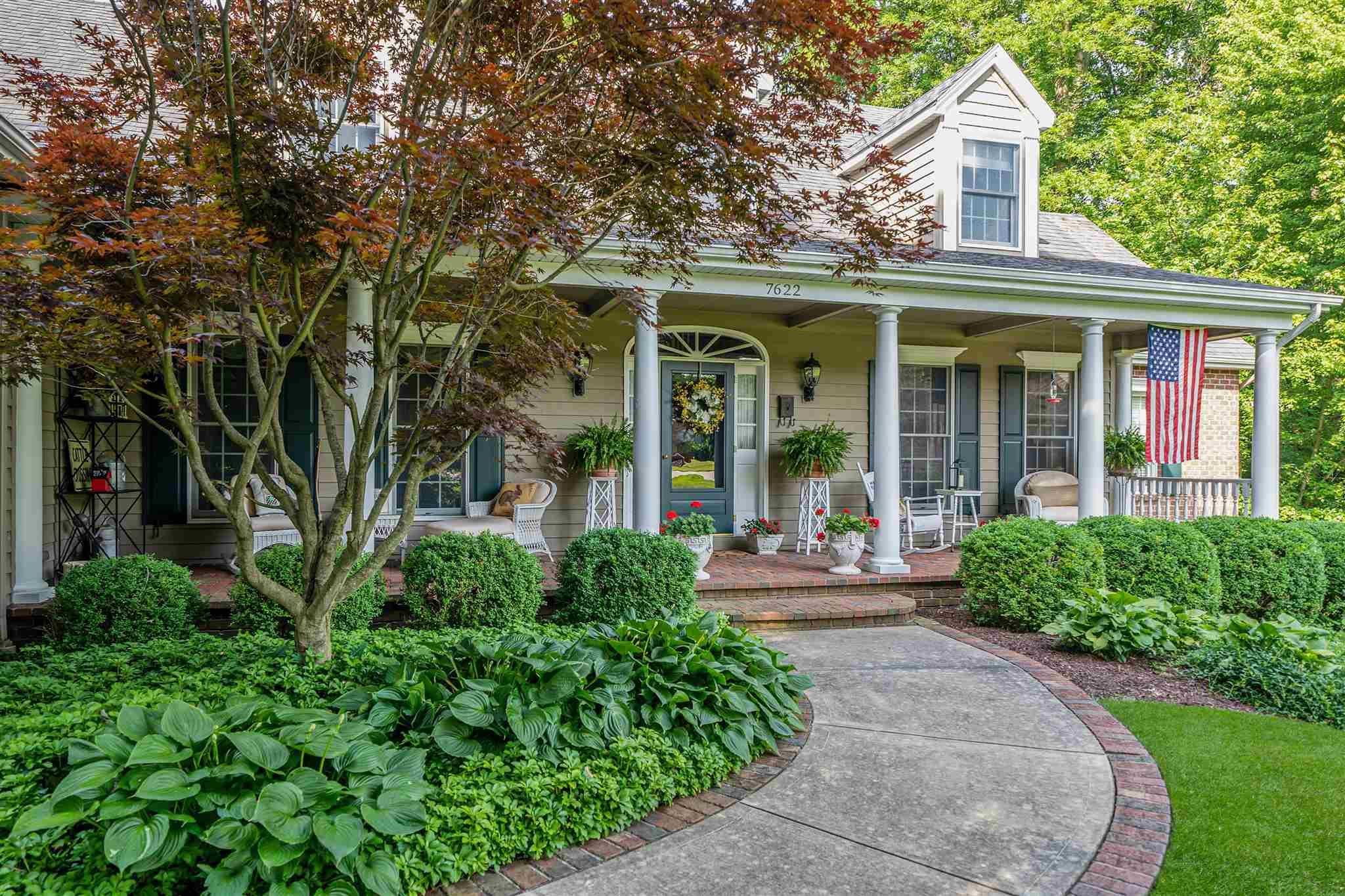 """QUALITY custom home in a peaceful setting just minutes from shopping, SWAC schools, hospitals & I-69! The covered front porch welcomes you into this Byall-built beauty. Boasting over 3800 sq ft above grade. The upgraded traditional floor plan means you enjoy both a 4 season room and a screened porch. Gourmet kitchen with built-in butler's pantry and kitchen hutch. Large island with prep sink opens to the hearth room and 4 season's room. Main floor primary suite with marble countertops in the ensuite, jetted tub and a shower built for two! Upstairs there are 2 bedrooms, each with their own ensuite and a bonus large finished attic space off bdrm 3 that has its own separate staircase opening into the kitchen/hearth. The lower level boats plenty of room for entertaining, a large guest room, full bath and loads of storage. 4 masonry fireplaces, coffered ceilings, crown & base molding galore and French doors grace this lovely home. Not a detail was overlooked! Constructed with 6"""" walls and I-beams."""