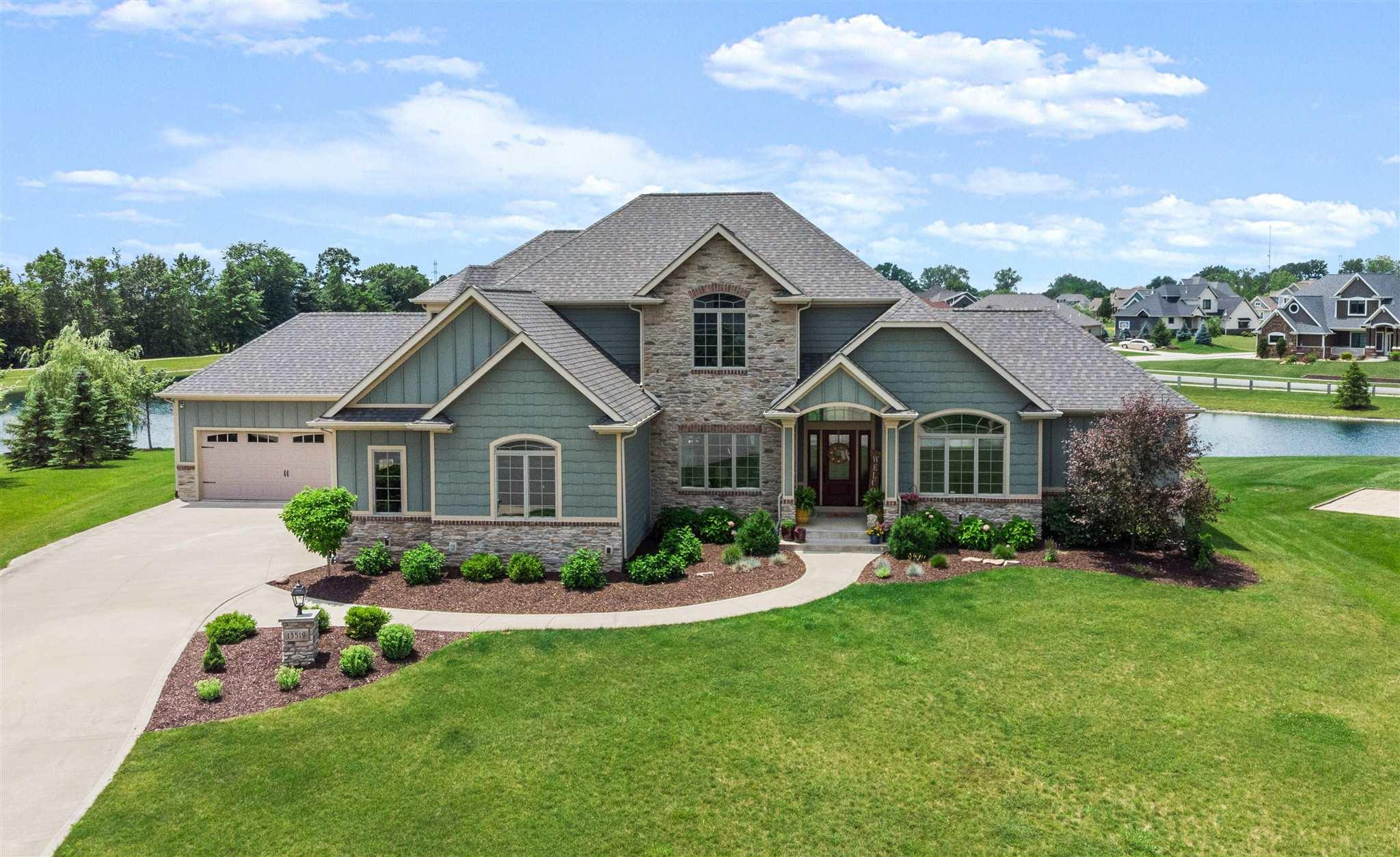 This gorgeous home in the highly sought-after Hawthorne Park Estates exudes casual elegance! From the minute you pull into the driveway, this 5 BR/4.5 BA home on a cul-de-sac pond lot will take your breath away! Step through the front door as a guest or the quaint side door as family. Inside you will find 20' ceilings and a wall of windows overlooking picturesque water views all along the back of the home. Make your way into the huge, gourmet kitchen and casual dining area which flows wonderfully to the cozy hearth room with cathedral ceilings and a fireplace flanked by built-in bookshelves. The home is designed with a split (2&2) garage plan entering the hallway off the kitchen with utility room, mud room and half bath. The master en suite has a gorgeous shiplap wall, trey ceiling, jetted tub, and large walk-in tile shower. Step upstairs to 3 nicely sized bedrooms, two of which share a Jack & Jill bath while one offers a private bath. The lower level has the 5th bedroom, full bath, family room plumbed for a future bar and flex space. The home sets itself apart with gorgeous, engineered flooring, mixed white & stained custom woodwork, custom ceilings, granite counters, tons of storage and so much more! Additional amenities include an irrigation system, security system, dual furnace & AC units, Ring doorbell & more. All this in the NWAC award winning schools close to I69, hospitals & shopping.