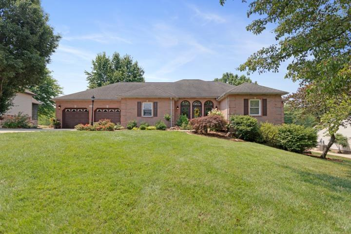 A custom built all brick home located on the Christmas Lake Village Golf Course tee #18. The house has been completely remodeled. The entrance of this home has lots of natural light with the triple doors in the entrance and the French doors that lead out to the covered deck in the back. The family room is spacious with trey ceilings. The whole house has 9 ft ceilings. There is a formal dining room to the left as you enter the house and an eat in kitchen which offers plenty of space for seating a large family or entertaining. The large kitchen has an abundance of cabinetry and an eat at breakfast bar. The counters are quartz and has a wonderful backsplash. The kitchen also has a nice pantry for extra storage. The master is on the main level that offers a very large room with tray ceilings, his and hers closets, and a custom shower. There is also another full bath and bedroom with tray ceilings on this level. The laundry room is on the main level as well with a nice folding area. Exit the French doors that lead out to a large covered porch with great views of the golf course. Travel downstairs to a large family room area with a walkout patio off of it. Their is a large bedroom in basement that could actually be split up to make two different bedrooms if needed. Their is lots of unfinished area in the basement for extra storage. In addition their is a golf cart garage or extra yard storage. Their is a full bathroom in basement as well. House has had a Heat Shield added in attic to help with heating and cooling efficiency.