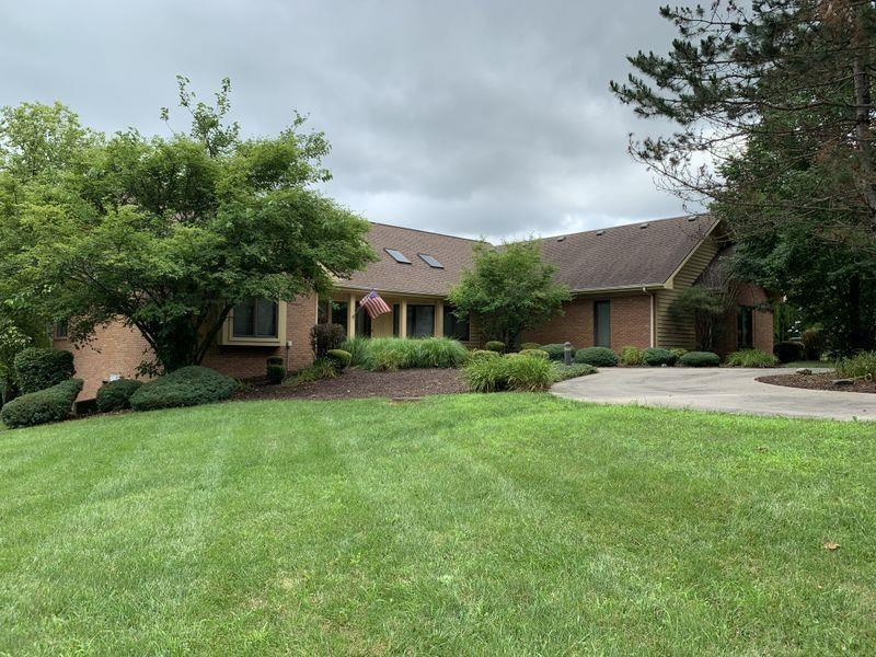 Spacious 5 bedroom brick home on quiet 12.25 acres. Home is nestled in woods with a 6 acre stocked pond with a beach for your quiet enjoyment.  Large kitchen spills over into a four seasons room that leads onto a large deck that overlooks the pond.  Master suite on main level with large bathroom with walk-in closet.  Spacious walkout basement with theater room, wet bar, woodstove, 2 bedrooms, full bath.  Lap pool, curved oak stairway, built-in vacuum, security system, corian kitchen counters, hardwood floors, 400 amp electric service, twin geo thermal systems (new in 2006), new roof in 2010 are just a few of the many features.  If you are looking for quiet peaceful living..... look no further!