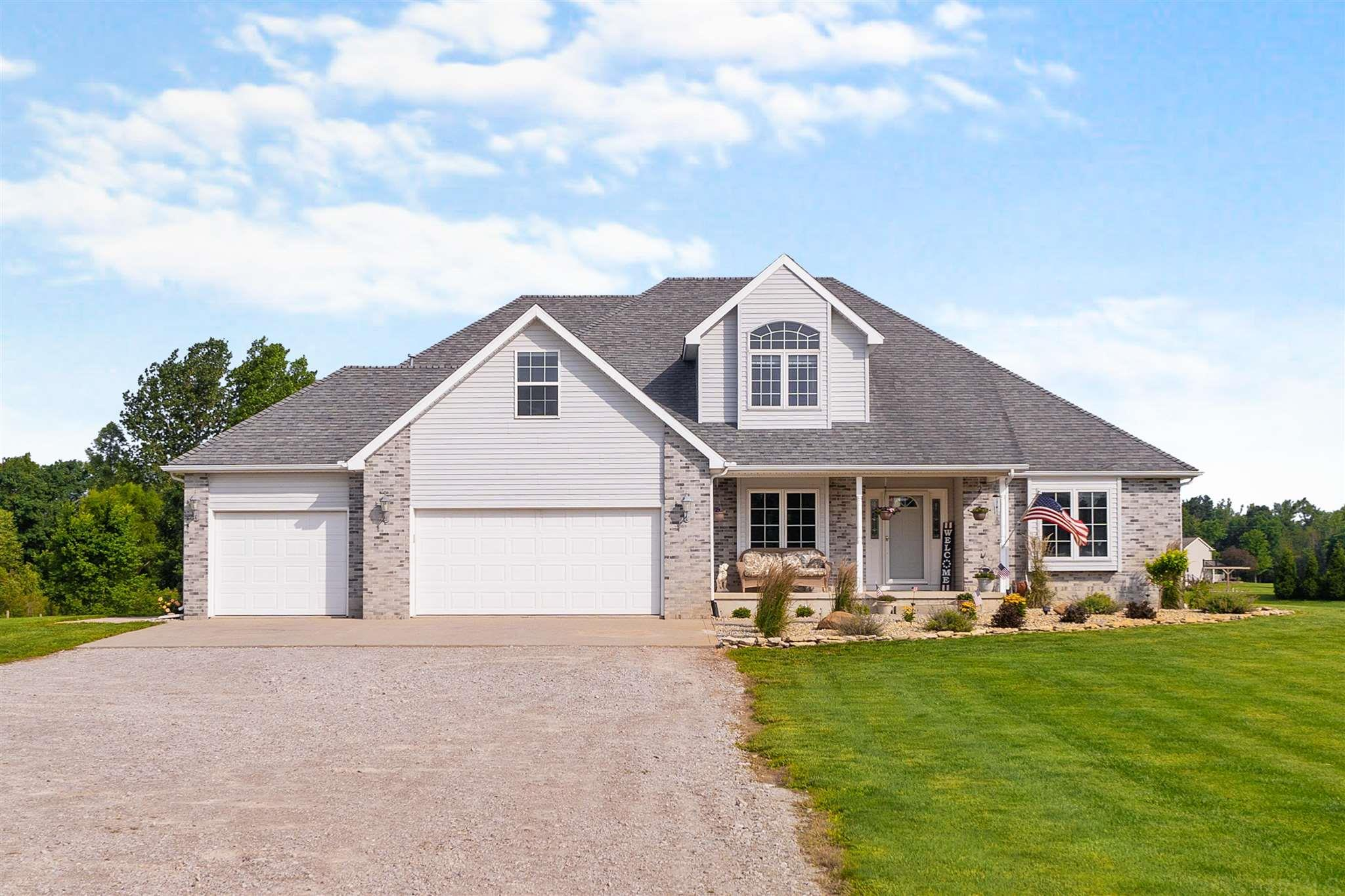 Live your best life on this sprawling 14+ Acre slice of paradise. This property boasts a long, beautiful winding driveway just southwest of Garrett with an easy commute to Fort Wayne. This custom built, two-story on a finished basement features 5 bedrooms (Could be 7 if the office were repurposed) and 3.5 bathrooms with a formal dining room, office, loft area, and a full kitchenette in the basement (basement could be used as a mother in-law suite). Entire interior was recently professionally repainted, as well as carpets professionally cleaned throughout. Outdoor space includes a fabulous 30X40 outbuilding with dual garage doors & with gorgeous interchangeable horse stalls, massive MULTIPLE horse pens/fencing on the property, as well as multiple recreational spaces. All major, stainless steel kitchen appliances are included in the sale. Master bedroom and laundry are both on the main level while the home highlights a split bedroom floor plan and a three-car garage with tall ceilings. Three sided fireplace between the main living space and dining nook. The home also has a fireplace in the basement. Approximately 5 or more Acres are currently tilled/farmed and are income producing. Survey & floor plan on file. Call your agent and schedule your showing today!