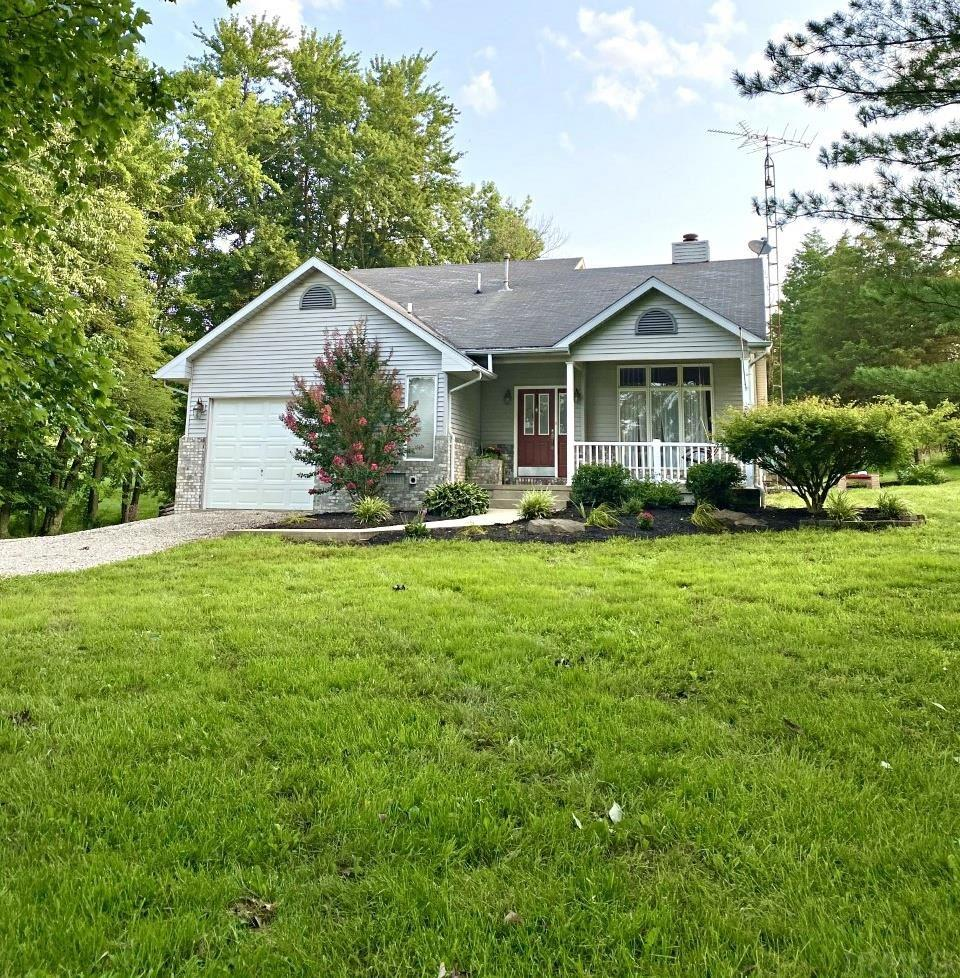 Come to the country and enjoy 5 acres +/- and this 3 bedroom, 3 bath home featuring open kitchen/dining, living room with beautiful stone fireplace and vaulted ceiling, 1-car attached garage, 1-car detached garage, and pond.