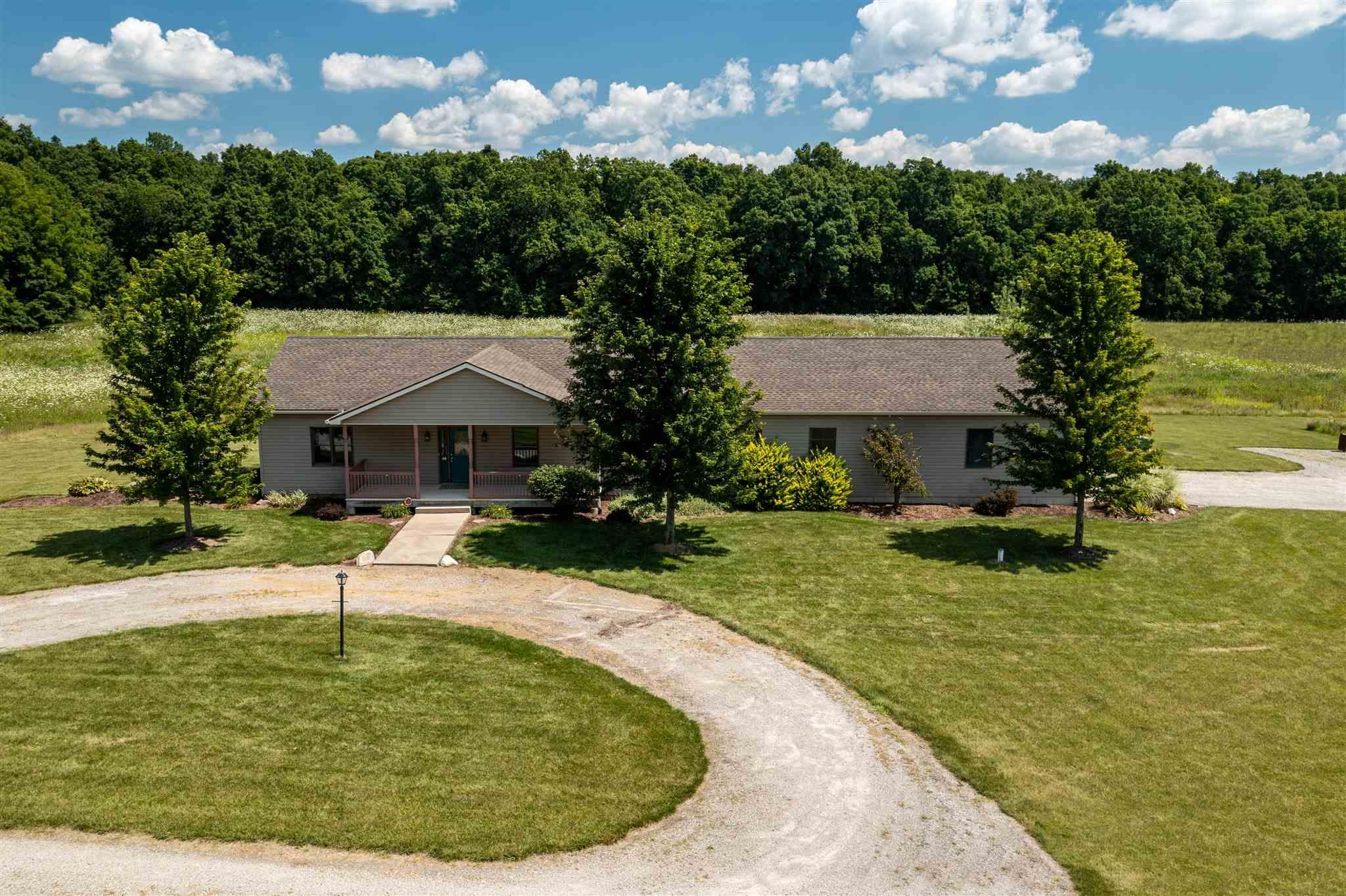 Hunters and fisherman's paradise! Spacious ranch home on 64 acres with a large pond. The back deck overlooks the large pond and 14 acres of woods. There is also a large Pole barn for all your toys. The home has a large mudroom off the garage that has stairs to the basement and a separate laundry room. There are two staircases. The daylight unfinished basement is plumbed for a full bathroom.