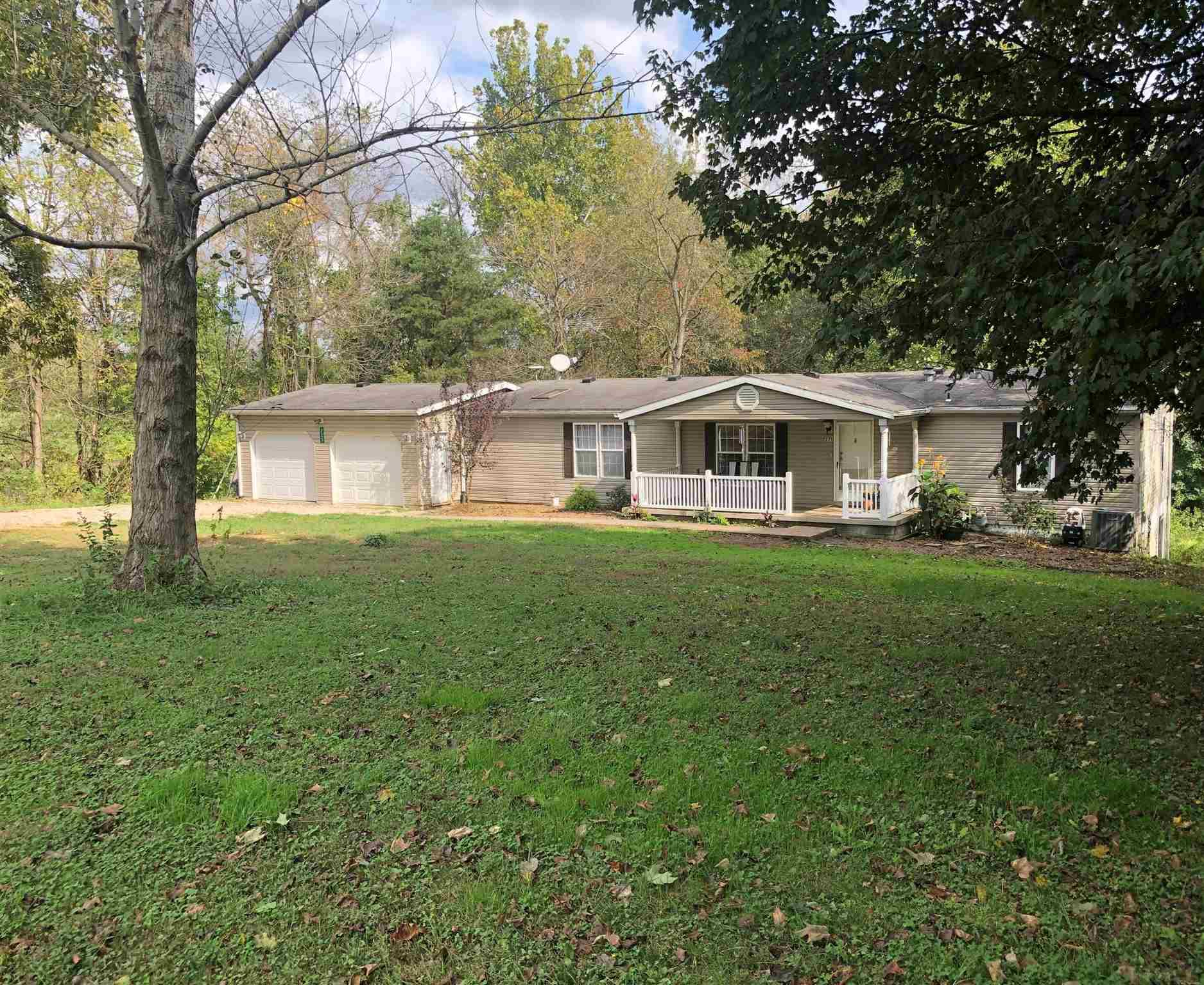 You'll love that this 4 bedroom, 2 bath home sits on almost 2 acres in a country and private setting, but still in the city limits. This home also offers a large living room, eat-in-kitchen and an elevated deck overlooking the partially wooded back yard. You won't fall short of storage in the full finished walk-out basement, 2 car attached garage or the large updated outbuilding. Also new is a completely remodeled bathroom with a touch of modern flare!