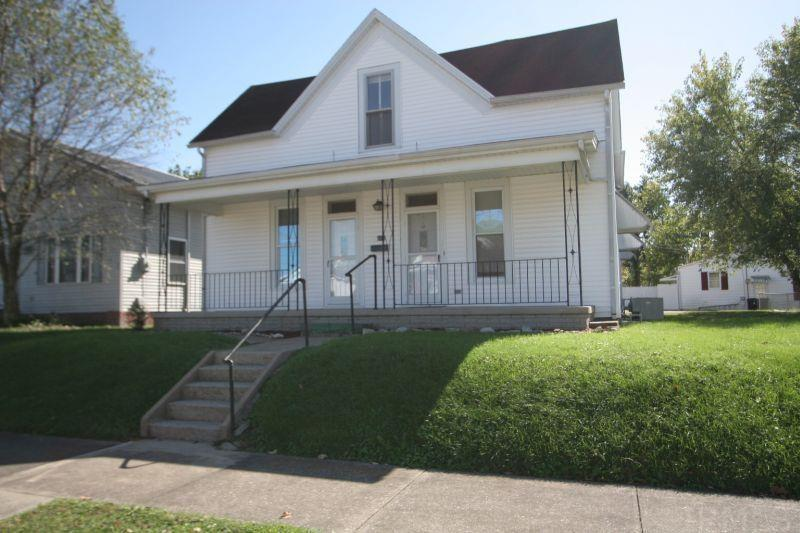 Located near downtown Huntingburg is this 1888 sq. ft. home. Almost completely updated throughout including new drywall, fresh paint, new laminate flooring, additional HVAC systems upstairs, replacement windows, appliances, and much more. Features include 4 bedrooms, and 1 1/2 bathrooms, a formal dining room and main floor bedroom.  The laundry room is also conveniently located on the main floor. The rear of the home offers a large gravel area for parking as well as a 2 car detached garage.