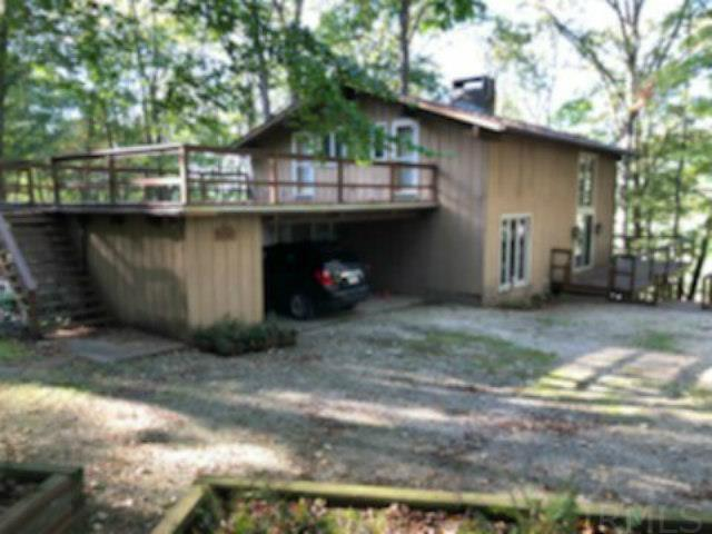 The house is a two story 3 bedroom house, one and half bathroom with wood siding.  It has 1008 square feet of space on the bottom floor land 816 sq. feet on the second floor - total 1824 sq. feet.  It has a 2 car carport and a 528 foot deck above it.  There is a 168 sq. foot deck on the east side of the house and a 288 sq. foot deck on the north side.   The house is situated in the midst of a forest with some beautiful large trees around it.  It has a live creek running through the property on the north side of the house.  The 2.65 acres of land borders along Hwy 545 and is located about one and half miles from the 6000 acre Patoka Lake and about 3 miles from the town of Dubois.