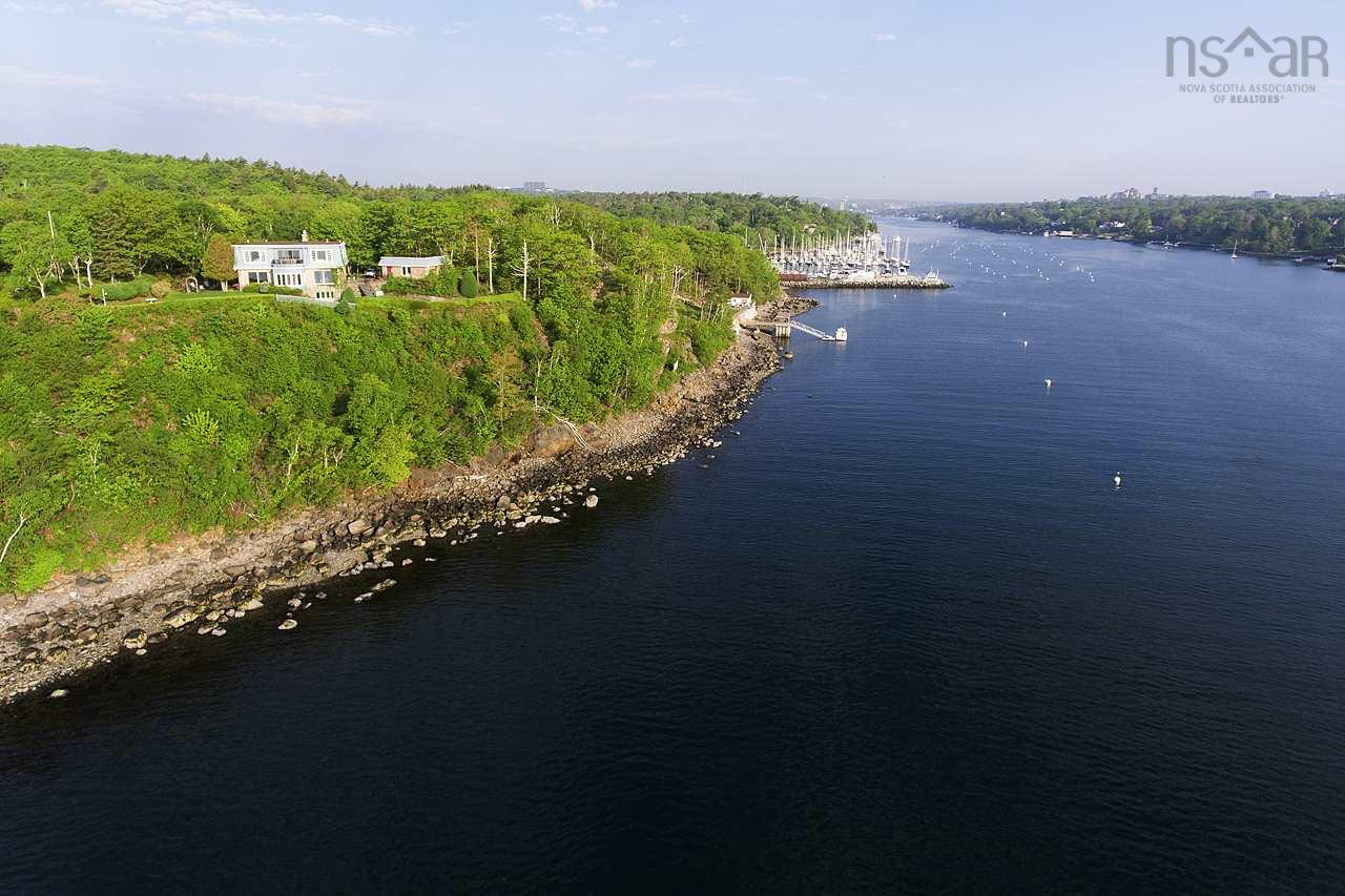 Absolutely stunning and unobstructed views and over 375' of waterfront!  You can see Point Pleasant Park, watch cruise ships sail by, or just enjoy the view from all angles.  This property is truly a rare find and the opportunities are endless.  With your very own water frontage it is perfect for the boater in the family. You may keep this treasure all to yourself or divide and build your dream and share the beauty with others   The home has been lovingly cared for and enjoyed, unique fixtures, one-of-a-kind spiral staircase from a local historic building  stain glass window, solid hardwood floors on the main level, ease of access for entertaining  and to the meticulously kept grounds, are just a few of the features.  You will not be disappointed and truly cannot appreciate the views unless you see them yourself.  Call for your private viewing today.