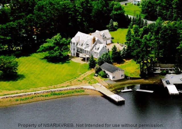 This custom designed home has been constructed of the greatest quality materials and workmanship. It is one of the most prestigious homes on the South Shore. The home is situated to provide magnificent views of the LaHave River. Offering a sheltered wharf, deep water mooring and boat slip the property is ideal for a boating enthusiast. This tremendous home features over 8,900 sq ft of finished living space plus a triple garage. Come and see the custom finishes throughout the property including, crown moulding, trim, doors, windows, hand cut