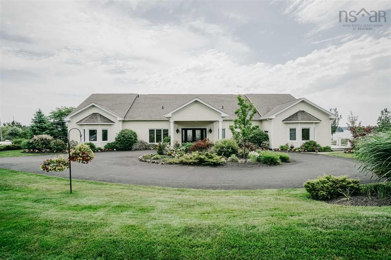 An outstanding estate that sits on 4.7 Acres with fabulous panoramic ocean views of the waters of Mahone Bay. This custom built home has many impressive details inside and out. The owners have meticulously thought of every detail of this 6000 sq foot home for them and their guests ,even wheelchair accessibility. Separate wings for the guests with their own en-suites and decks with gorgeous views. The Master bedroom has its own lounging area with fireplace, separate his and her walk in closets and en-suites. A sensational DeCoste Kitchen in the centre of the home with everything you could imagine at your fingertips. From formal living to everyday living this floor plan allows for it all. Plus don't forget the 1000 sq foot recreational area on the upper level, the triple car garage that will house your RV, boat or any other toys you have. Across the street is 2 waterfront lots for you to develop with so many potentials and a mooring for your boat. Call us today for your private tour of this fabulous home.