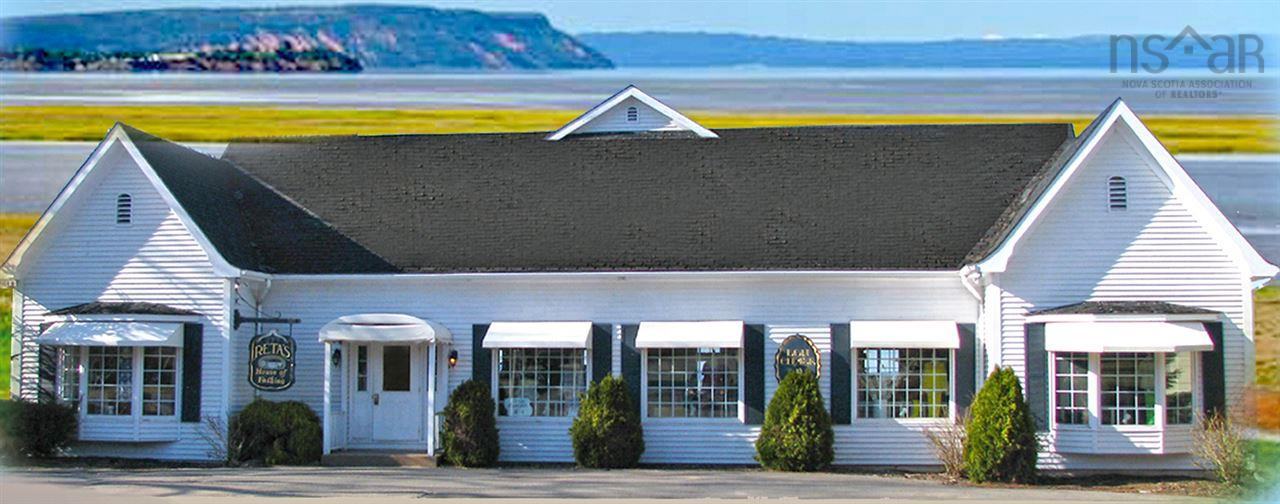 A wonderful commercial opportunity available in the core of Wolfville with lots of parking and fabulous views.  Offering over 4000 Sq.Ft. of main level finished area, this building includes an upper level presently used as a seasonal accommodations with own entrance and office area. The open layout of the main area and the views from the rear to the dyke lands make it suitable for many uses including (but not limited to) a boutique inn, tea room, retail, office or combination. The lower level has its own separate side entrance that has access to over 2100 Sq.Ft of dry storage or other possibilities. Ideally located near Grande Pre, a world heritage Unesco site. The views of Cape Blomidon and the Minas Basin are added bonuses as to why you should situate your business here.